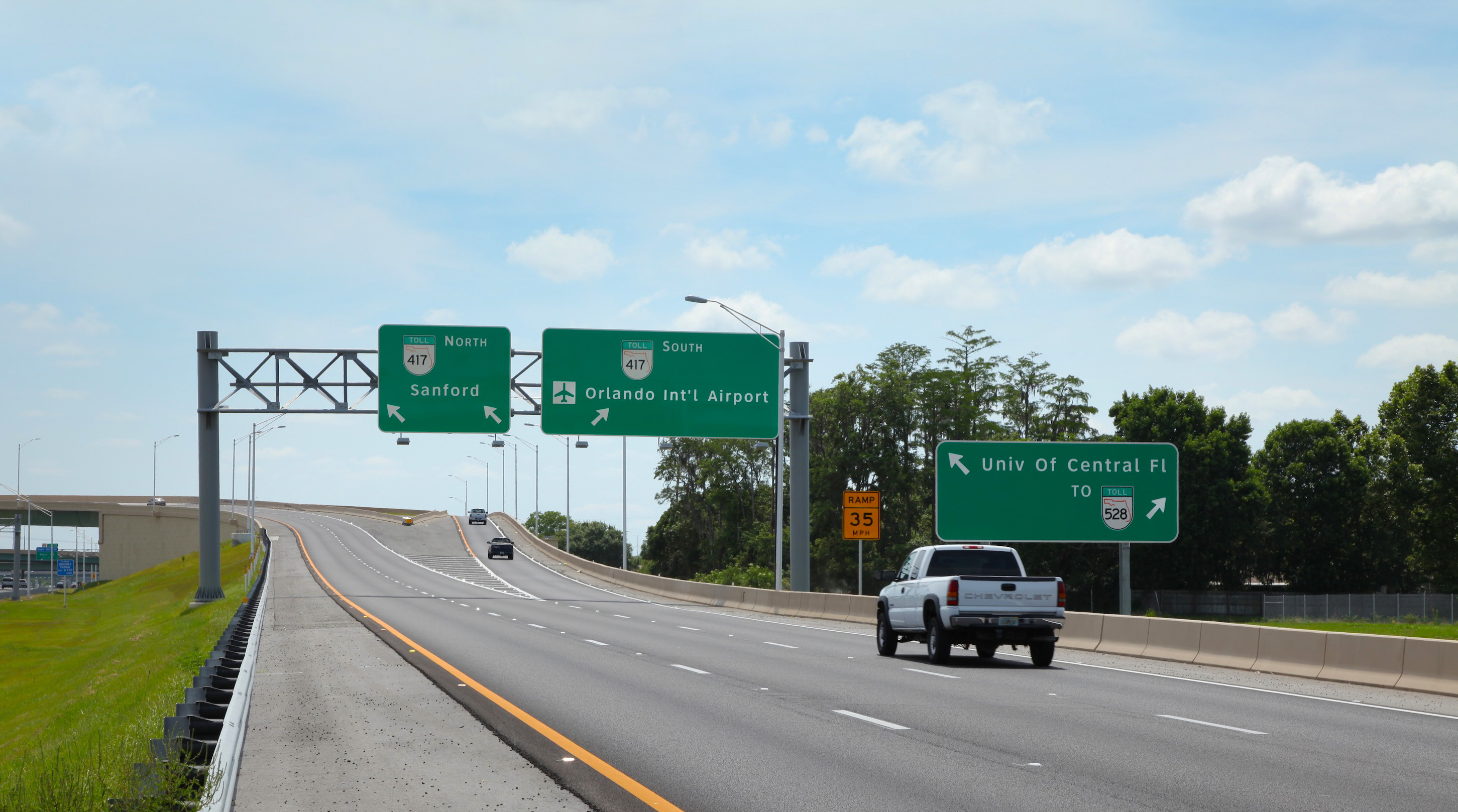 State Road 417 exchange. Road splits left 417 North to Sanford, right 417 South to Orlando International Airport