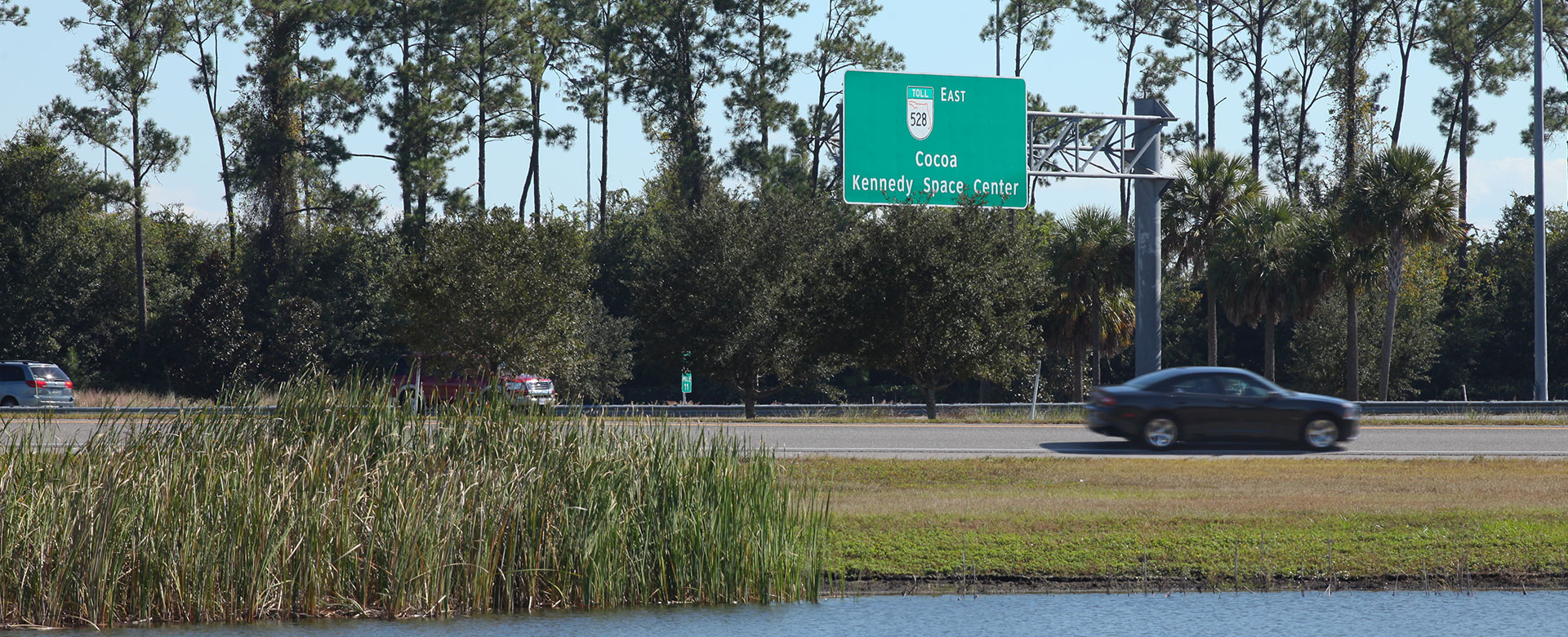 Central Florida Expressway road sign for toll road 528 East to Cocoa Beach Kennedy Space Center