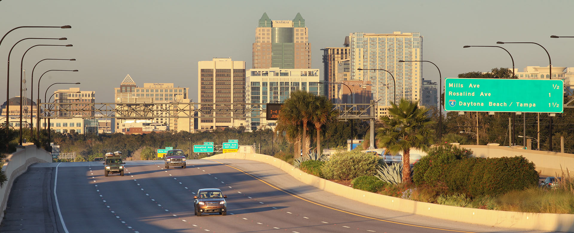 Central Florida Expressway toll road 408 near downtown Orlando. Sign for exits to Mills Avenue, Rosalind Avenue, and Interstate 4 to Daytona Beach/Tampa