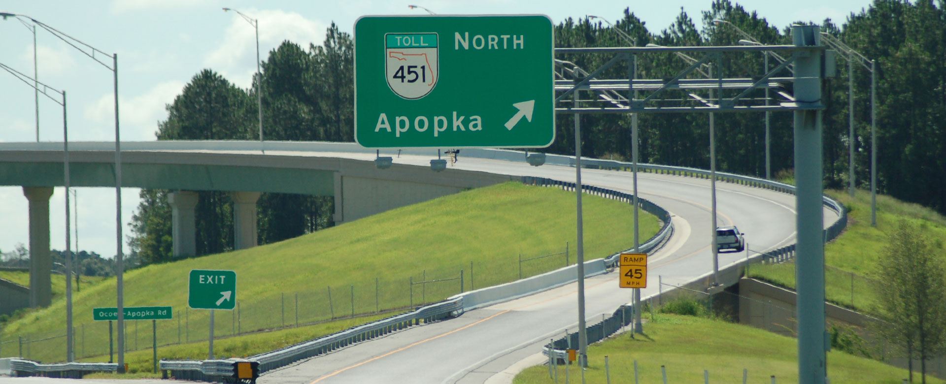Exit road sign for Central Florida Expressway toll road 451 North to Apopka