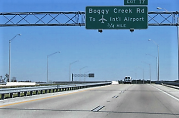 Road sign for Exit 17 Boggy Creek Road to Orlando International Airport