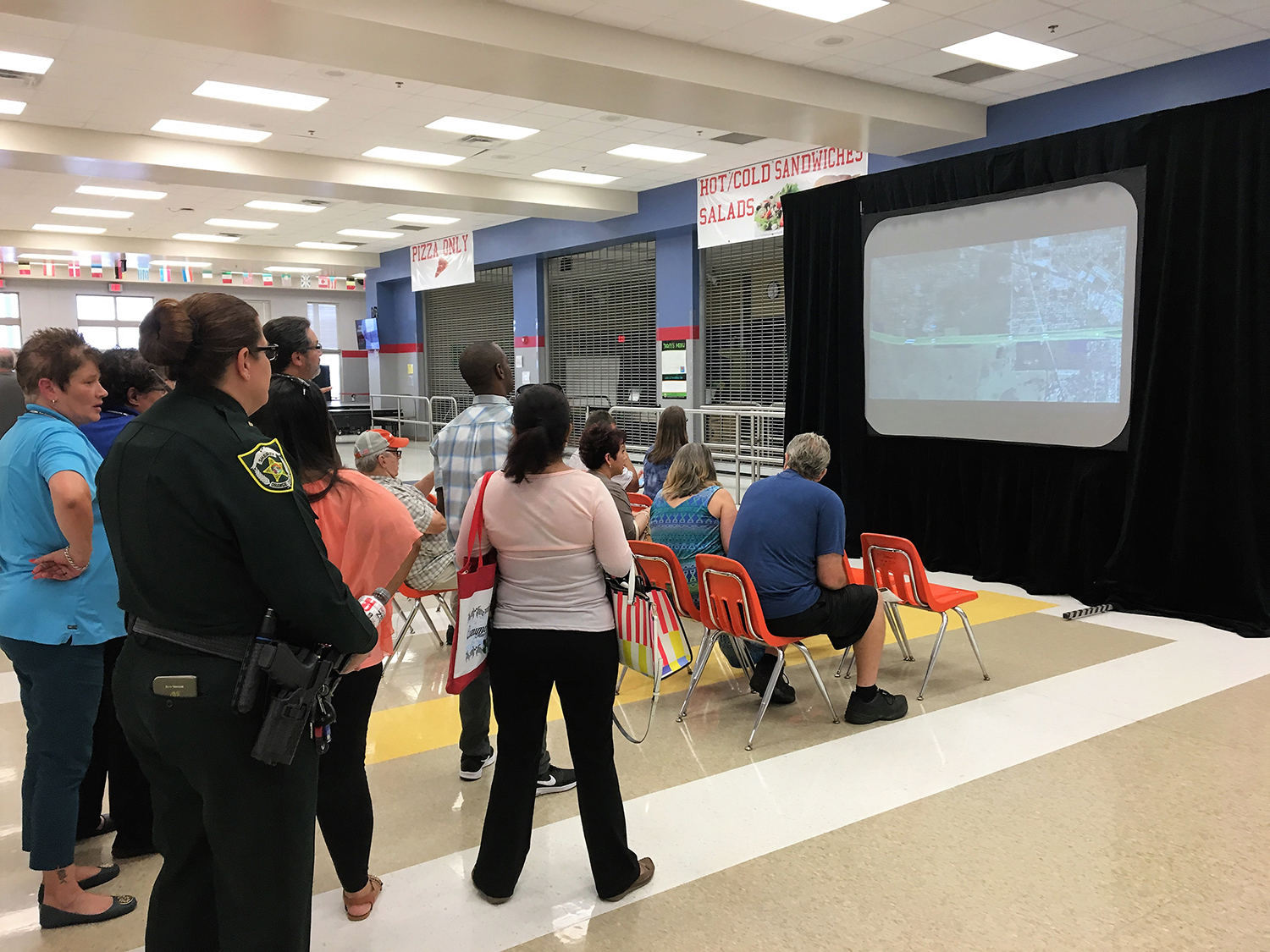 Citizens attend a presentation of the PD&E Study for State Road 408 Eastern Extension during a public meeting