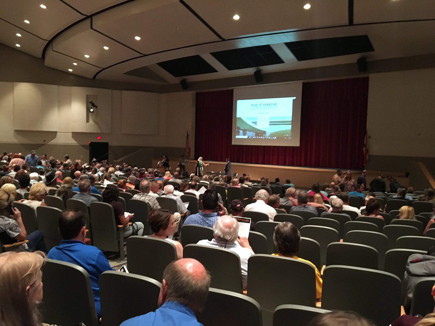 Citizens attend a public meeting regarding the PD&E study of State Road 408 Eastern Extension