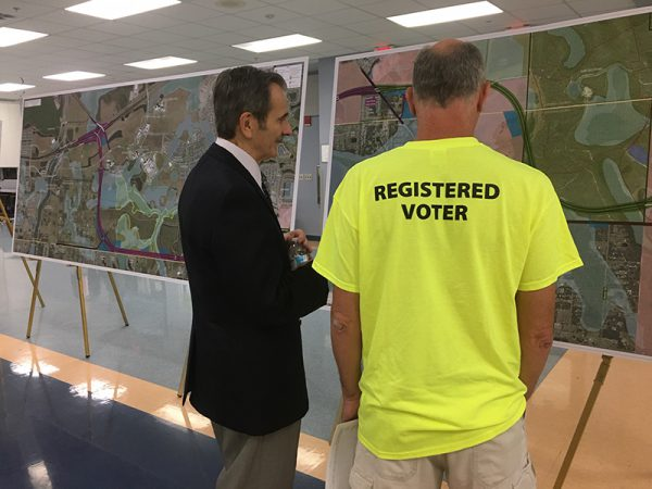Registed voters examine map plans at Osceola Parkway Extension Public Meeting