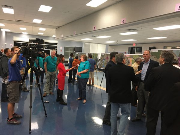 Citizens interviewed by local news crew during Osceola Parkway Extension Public Meeting