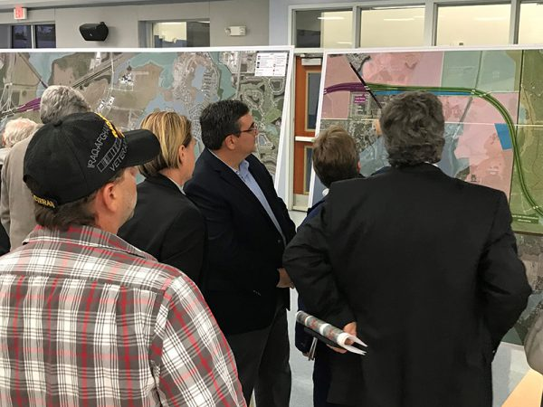 Citizens examine maps at Osceola Parkway Extension Public Meeting