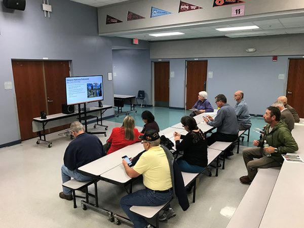 Citizens watch presentation at Osceola Parkway Extension Public Meeting