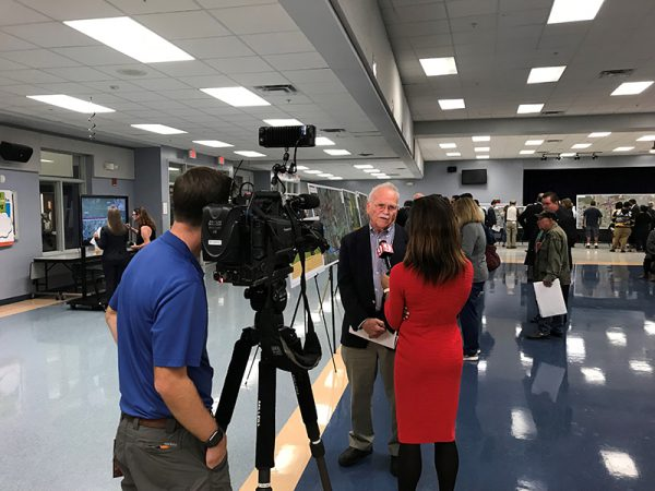 Local news crew interviews citizens at Osceola Parkway Extension Public Meeting