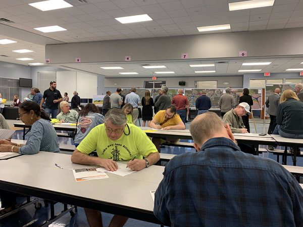 Citizens making notes at Osceola Parkway Extension Public Meeting