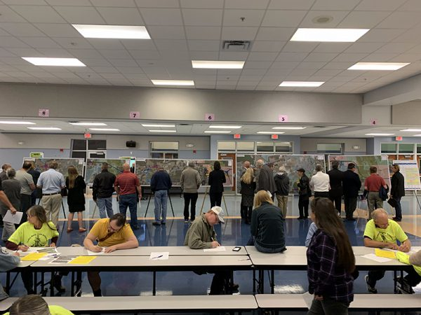 Citizens examine Osceola Parkway Extension maps at Public Meeting
